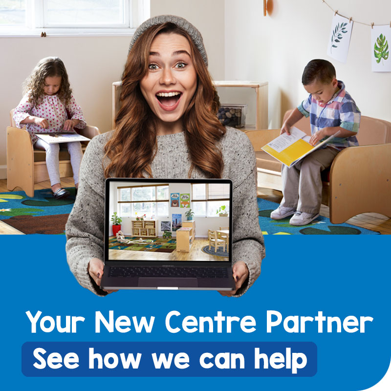 Happy educator in a childcare room, sharing her new centre design. See how we can help design your new centre.